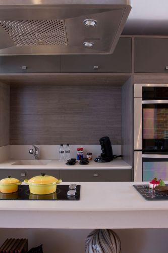 Com a integração dos ambientes, a coifa Eletrolux é um elemento fundamental que garante o ar purificado