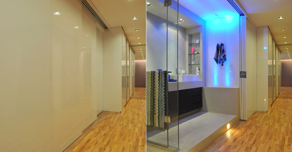 A iluminação (da Reka) ajuda a destacar a sala de banho do quarto, onde o piso é de madeira (Assoalhos Morumbi). Na sala de banho o revestimento principal é o tecnocimento que tem base cimentícia de alta aderência, executado pela NS Brazil