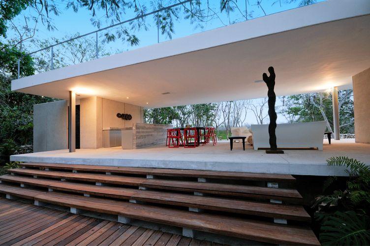 Construída entre 52 árvores, a casa