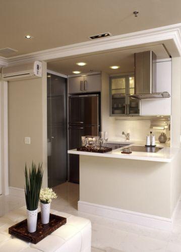 decoracao cozinha flat:pequena cozinha americana é completa com fogão cooktop, coifa