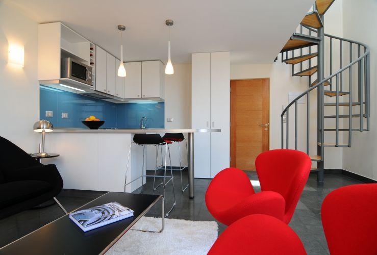 decoracao cozinha loft: ao piso mais alto do loft triplex Marcos Mendizabal/Divulgação Mais