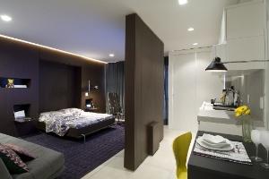 Sala de estar e quarto se alternam em apartamento de apenas 50 m² - Divulgação