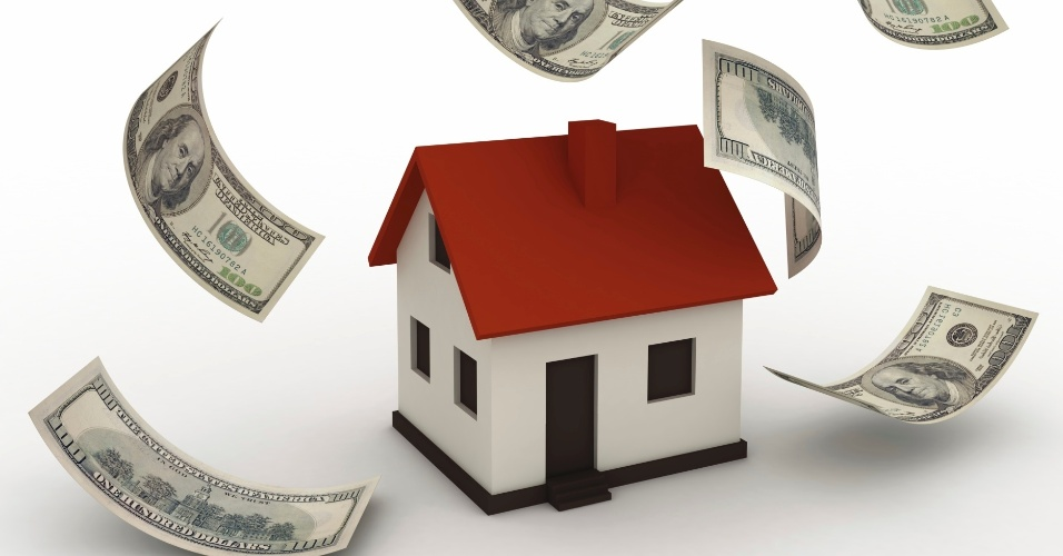 Maquete de casa com notas cédulas de dinheiro caindo sobre ela, simbolizando pagamento de casa própria