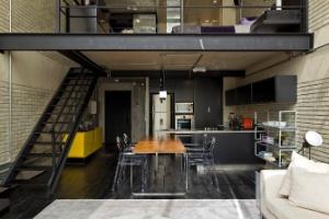 Modernização extingue paredes e revela estruturas metálicas de loft de 100 m² - Alain Brugier/Divulgação